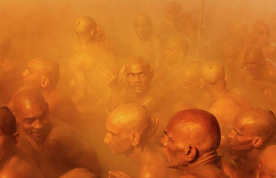 Hindu holy men of the Juna Akhara sect participate in rituals that is believed to rid them of all ties in this life and dedicate themselves to serving God as a 'Naga' or naked holy men, after taking dips at Sangam, the confluence of the Ganges and Yamuna River during the Maha Kumbh festival in Allahabad, India, early Thursday, Jan. 31, 2013. The significance of nakedness is that they will not have any worldly ties to material belongings, even something as simple as clothes. This ritual that transforms selected holy men to Naga can only be done at the Kumbh festival. Photo: Rajesh Kumar Singh, Associated Press / AP