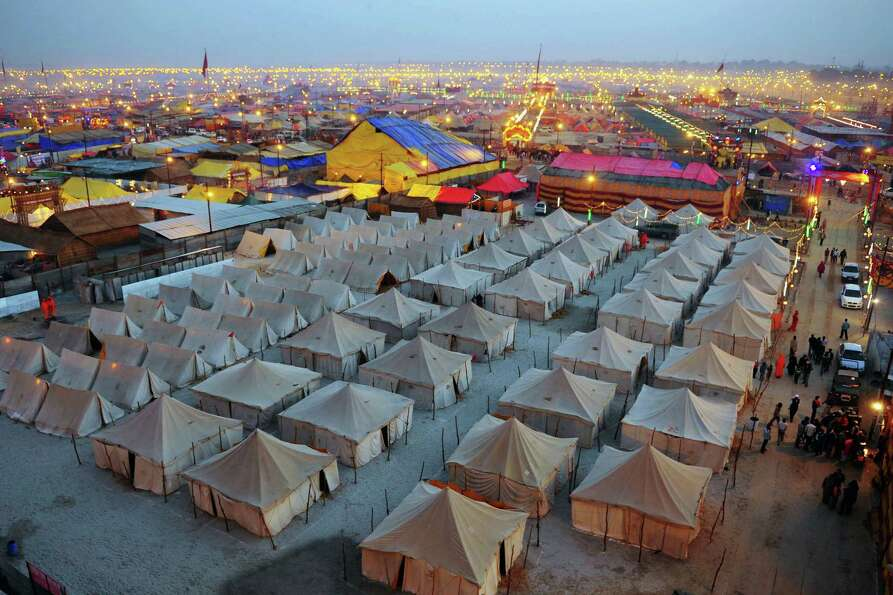 Temporary tents for devotees are pictured at dusk at Sangam, the confluence of the Rivers Ganges, Ya