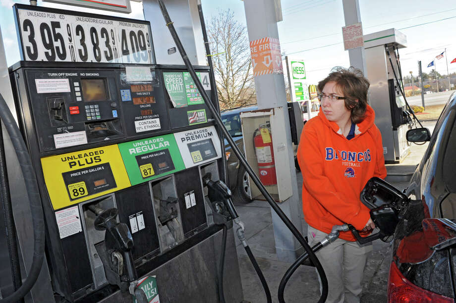Meghann Sanday of Stillwater pumps regular gas costing $3.83 a gallon into her car at a Hess station Wednesday afternoon, Feb. 6, 2013, in Wilton, N.Y.  (Lori Van Buren / Times Union) Photo: Lori Van Buren