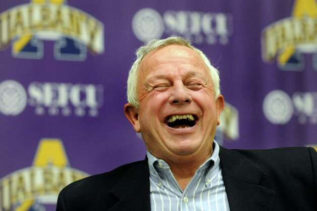 UAlbany football coach Bob Ford laughs with the media and his coaches after announcing this year's recruiting class during a news conference on Wednesday, Feb. 6, 2013, at UAlbany in Albany, N.Y. (Cindy Schultz / Times Union) Photo: Cindy Schultz / 10021059A
