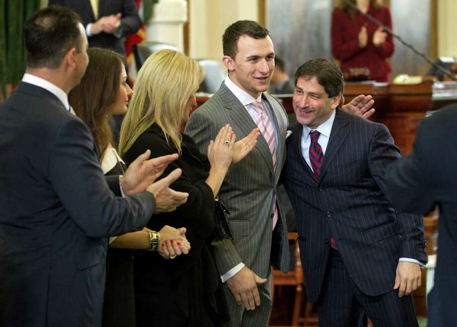 Johnny Manziel, second from right, Texas A&M Heisman Trophy-winning quarterback, is congratulated by Texas Sen. Kevin Eltife, R-Tyler, at the Senate Chamber at the Capitol in Austin, Texas, on Feb. 6, 2013.  Applauding are, left to right, father John Paul Manziel, sister Mary Manziel and mother Michelle Manziel.  Both the Texas House and the Senate passed resolutions congratulating the football star. Photo: Jay Janner, Associated Press / Austin American-Statesman