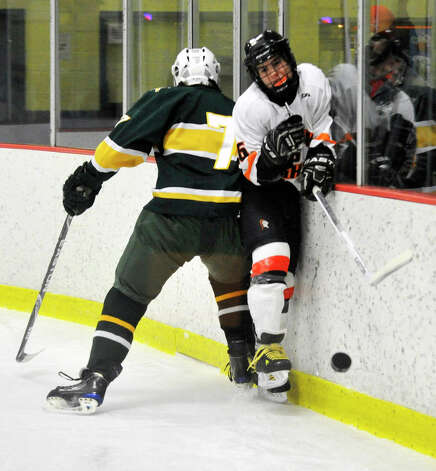 Trinity Catholic's Daniel Davis collides with Stamford's Christian Mallozzi during the city championship game at Terry Conners Rink in Stamford on Wednesday, Feb. 6, 2013. Trinity Catholic beat Stamford, 2-1. Photo: Jason Rearick / The News-Times