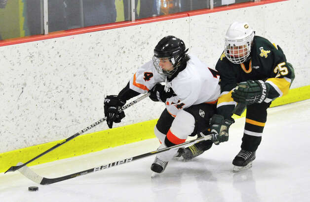 Trinity Catholic's Jordan Skiba reaches his stick in on Stamford's Michael Zarrilli during the city championship game at Terry Conners Rink in Stamford on Wednesday, Feb. 6, 2013. Trinity Catholic beat Stamford, 2-1. Photo: Jason Rearick / The News-Times