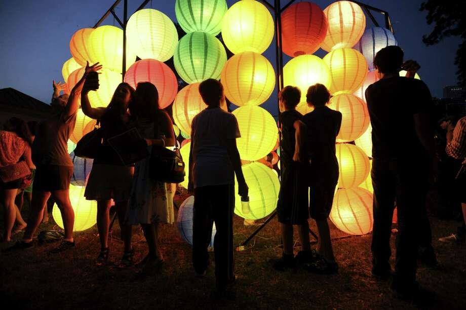 A Luminaria crowd explores a display in 2012. The event is expanding this year, encompassing Alamo Street from Market to César Chávez and the River Walk as well as HemisFair Park. Photo: Express-News File Photo