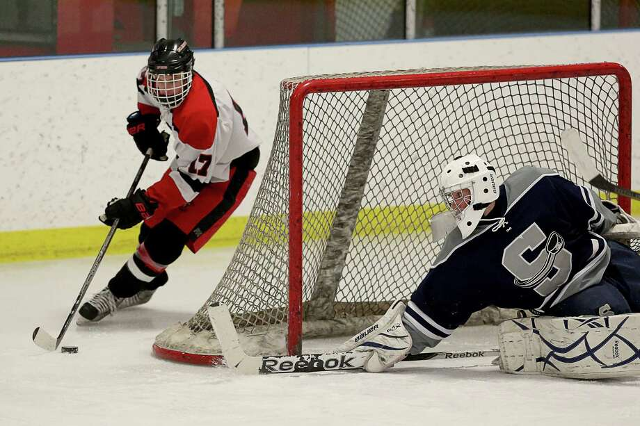Mike Ross Connecticut Post freelance -Fairfield Ward Ludlowe #17 Christopher Logan takes shot on Staples/ Weston / Shelton's goalie # 1 William Englehart during first period action on Wednesday evening. Photo: Mike Ross / www.mikerossphoto.com