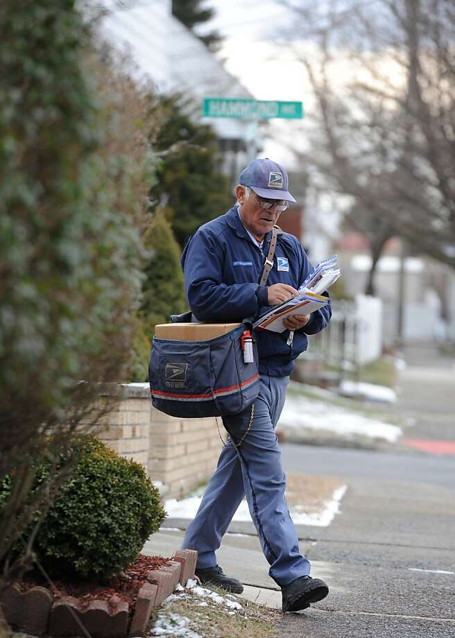 Mauro Badillo delivers the mail in Clifton, N.J., which the Postal Service wants to end on Saturdays starting in August. Photo: Tyson Trish, Associated Press