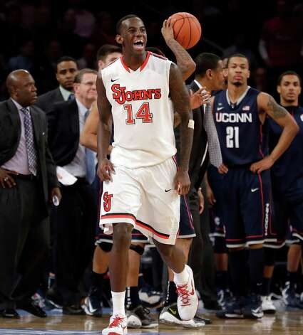 St. John's forward Jakarr Sampson (14) reacts in the second half of their NCAA college basketball game against Connecticut at Madison Square Garden in New York, Wednesday, Feb. 6, 2013. St. John's won 71-65. (AP Photo/Kathy Willens) Photo: Kathy Willens, Associated Press / AP