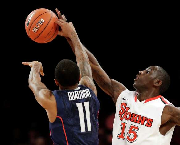 St. John's Sir'Dominic Pointer (15) blocks a pass by Connecticut guard Ryan Boatright (11) in the second half of their NCAA college basketball game at Madison Square Garden in New York, Wednesday, Feb. 6, 2013.  St. John's won 71-65. (AP Photo/Kathy Willens) Photo: Kathy Willens, Associated Press / AP