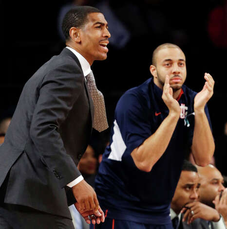 Connecticut head coach Kevin Ollie, left, reacts in the first half of their NCAA college basketball game against St. John's at Madison Square Garden in New York, Wednesday, Feb. 6, 2013. St. John's won 71-65. (AP Photo/Kathy Willens) Photo: Kathy Willens, Associated Press / AP