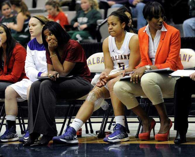 UAlbany's Ebone Henry (5) sits on the bench with a ice bag on her knee during the second half after