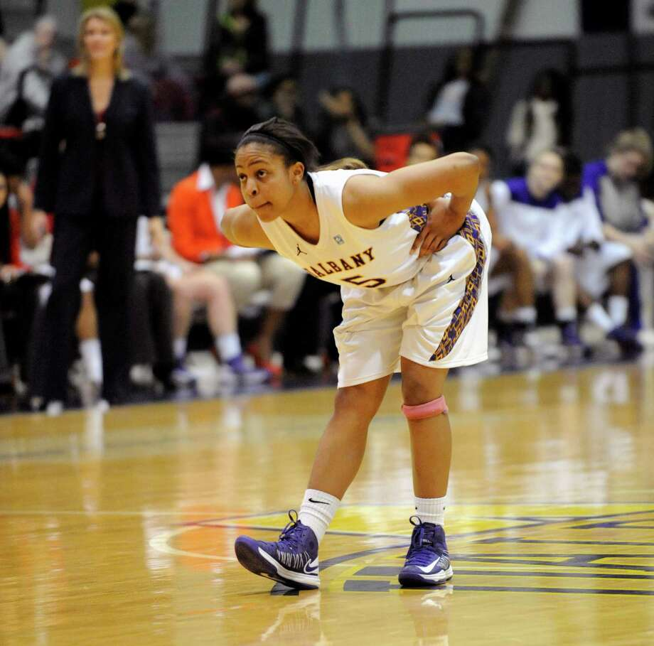 UAlbany's Ebone Henry (5) favors her knee while defending against UMBC's during their America East Conference basketball game in Albany, N.Y., Wednesday, Feb. 6, 2013. (Hans Pennink / Special to the Times Union) College Sports Photo: Hans Pennink / Hans Pennink