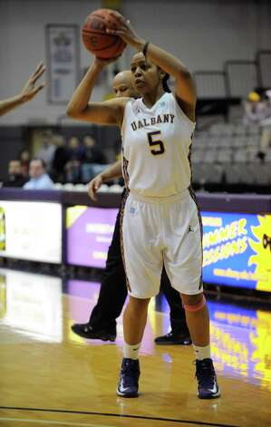 UAlbany's Ebone Henry (5) shoots against UMBC's during their America East Conference basketball game in Albany, N.Y., Wednesday, Feb. 6, 2013. (Hans Pennink / Special to the Times Union) College Sports Photo: Hans Pennink / Hans Pennink