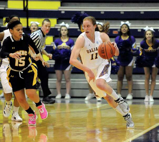 UAlbany's Julie Forster (11) moves the ball against UMBC's Raven Harris (15) during their America Ea