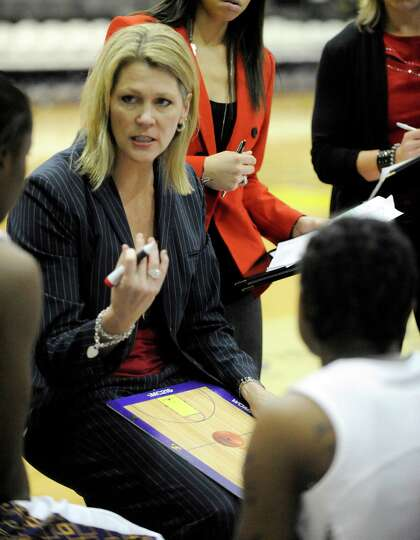 UAlbany head coach Katie Abrahamson-Henderson coaches her players against UMBC's during their Americ