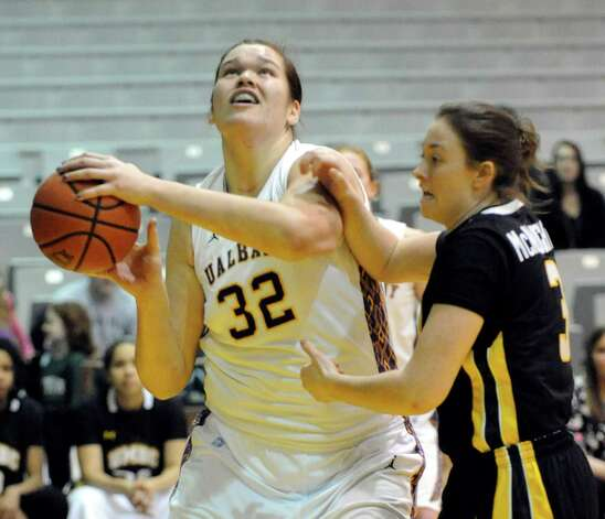 UAlbany's Megan Craig (32) shoots while being defended by UMBC's Liz McNaughton (3) during their America East Conference basketball game in Albany, N.Y., Wednesday, Feb. 6, 2013. (Hans Pennink / Special to the Times Union) College Sports Photo: Hans Pennink / Hans Pennink
