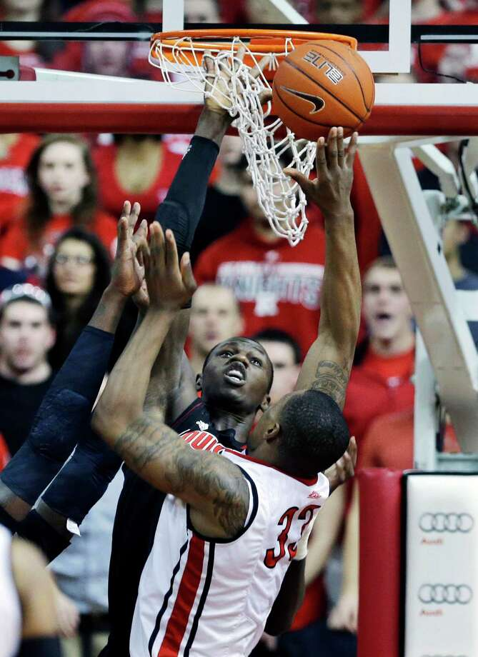 Louisville's Gorgul Dieng, of Senegal, goes up to block a shot by Rutgers' Wally Judge (33) during the first half of an NCAA college basketball game on Wednesday, Feb. 6, 2013, in Piscataway, N.J. (AP Photo/Mel Evans) Photo: Mel Evans