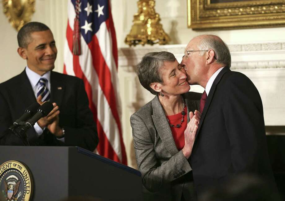"""Ken Salazar kisses Sally Jewell, nominated to succeed the Interior secretary by an applauding President Barack Obama, who says, """"She knows the link between conservation and good jobs."""" Photo: Doug Mills / New York Times"""