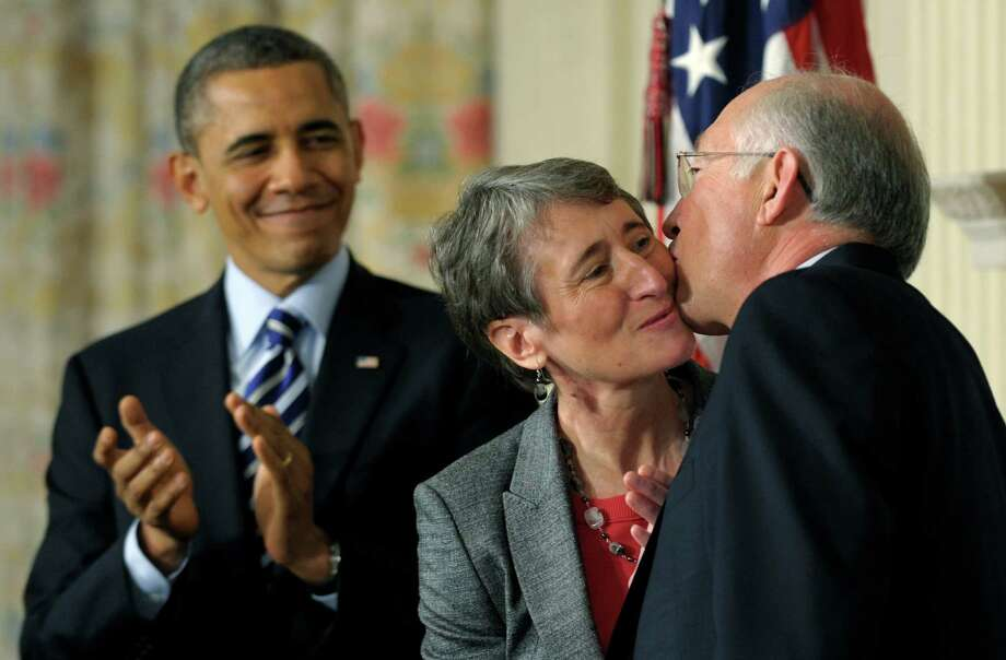 President Barack Obama watches as his Interior Secretary nominee, REI Chief Executive Officer Sally Jewell, center, gets a kiss from outgoing Interior Secretary Ken Salazar, Wednesday, Feb. 6, 2013, in the State Dining Room of the White House in Washington, where the president announced that Jewell is his choice to replace Salazar. (AP Photo/Susan Walsh) Photo: Susan Walsh