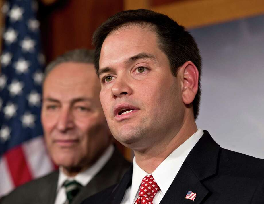 FILE - In this Jan. 28, 2013, photo, Sen. Marco Rubio, R-Fla., right, and Sen. Charles Schumer, D-N.Y., left, join a bipartisan group of leading senators to announce that they have reached agreement on the principles of sweeping legislation to rewrite the nation's immigration laws at the Capitol in Washington. Rubio, a leading proponent of overhauling the immigration system who has gained attention in GOP circles, will deliver the Republican response to President Barack Obama's State of the Union address on Tuesday. (AP Photo/J. Scott Applewhite) Photo: J. Scott Applewhite