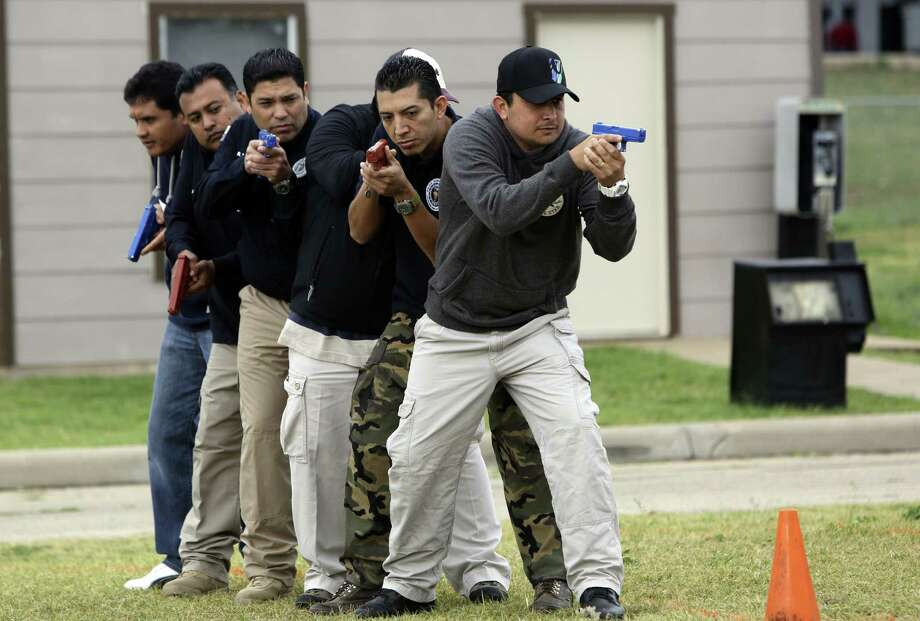About 20 Mexican police officers were selected to participate in the Mexican American Liaison and Law Enforcement training. Photo: Helen L. Montoya / San Antonio Express-News