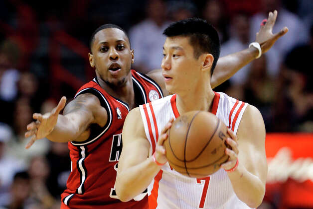 Heat guard Mario Chalmers, left, defends against Rockets guard Jeremy Lin. Photo: Wilfredo Lee, Associated Press / AP