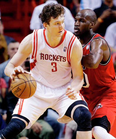 Rockets center Omer Asik (3) drives against Heat center Joel Anthony. Photo: Wilfredo Lee, Associated Press / AP