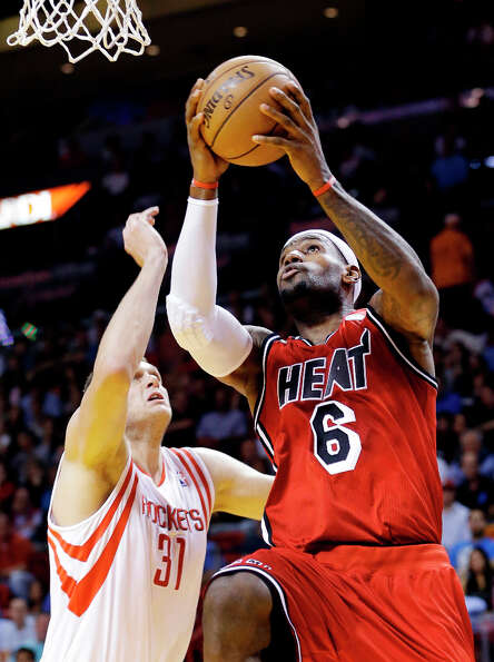 Heat forward LeBron James (6) shoots against Rockets center Cole Aldrich.