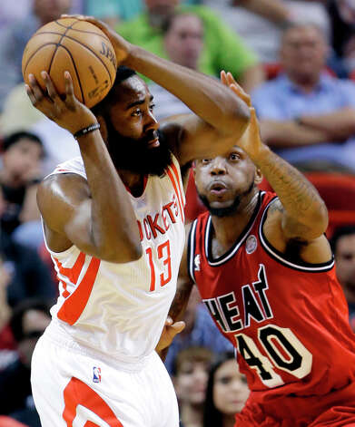 Rockets guard James Harden (13) looks for an open teammate past Heat forward Udonis Haslem. Photo: Wilfredo Lee, Associated Press / AP