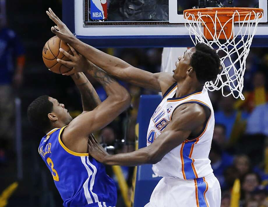 Oklahoma City Thunder center Hasheem Thabeet (34) blocks a shot by Golden State Warriors forward Jeremy Tyler (3) during the fourth quarter of an NBA basketball game in Oklahoma City, Wednesday, Feb. 6, 2013. Oklahoma City won 119-98. (AP Photo/Sue Ogrocki) Photo: Sue Ogrocki, Associated Press
