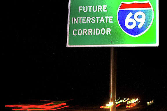 """**ADVANCE FOR WEEKEND NOV. 30-DEC. 1 ** FILE ** A roadside sign marks the path of Interstate 69  near Texarkana, Texas, as seen in this May 23, 2002, file photo. Interstate 69 was dubbed the """"NAFTA Superhighway"""", a new interstate to link Canada to Mexico with the goal of easing truck congestion and international access for U.S. goods."""