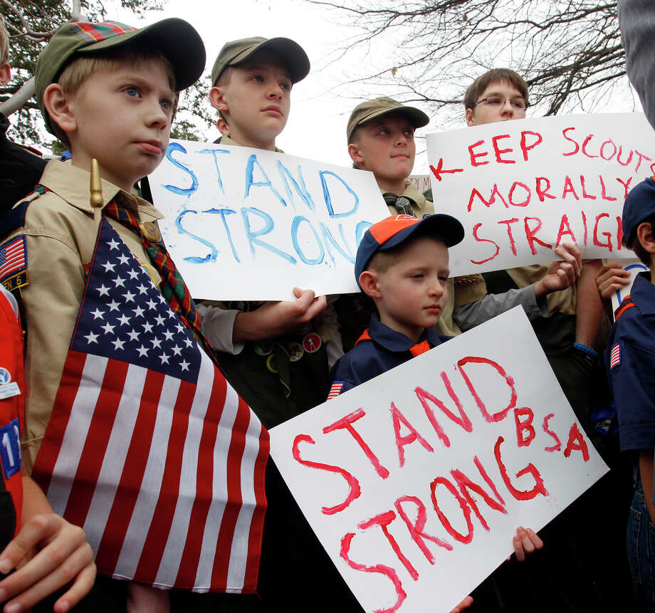 "Clockwise from left,  Boy Scouts Eric Kusterer, Jacob Sorah, James Sorah, Micah Brownlee and Cub Scout John Sorah hold signs at the ""Save Our Scouts"" Prayer Vigil and Rally in front of the Boy Scouts of America National Headquarters in Irving, Texas, Wednesday, February 6, 2013.  The Boy Scouts of America said Wednesday it needed more time before deciding whether to move away from its divisive policy of excluding gays as scouts or adult leaders.  (AP Photo/Richard Rodriguez) Photo: Richard W. Rodriguez"