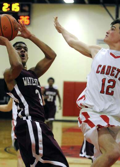 Watervliet's Ty'Jon Gilmore drives to the basket defended by Albany Academy's Rory Flaherty during t