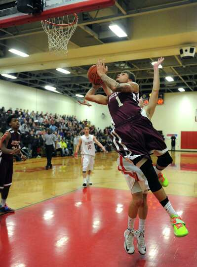 Watervliet's Jordan Gleason drives to the basket during their boy's high school basketball game agai