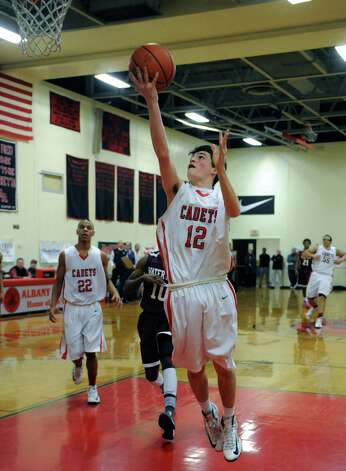 Albany Academy's Rory Flaherty goes in for a basket during their boy's high school basketball game against Watervliet on Wednesday Feb. 6, 2013 in Albany, N.Y. .(Michael P. Farrell/Times Union) Photo: Michael P. Farrell