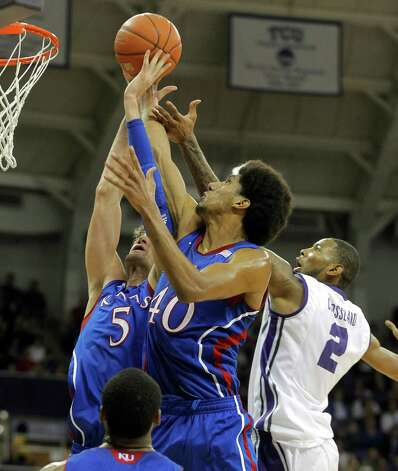Kansas Jayhawks center Jeff Withey (5) and forward Kevin Young (40) fight Texas Christian Horned Frogs forward Connell Crossland (2) for a rebound in the first half at Daniel Meyer Coliseum in Fort Worth, Texas, Wednesday, February 6, 2013. (Rodger Mallison/Fort Worth Star-Telegram/MCT) Photo: RODGER MALLISON, McClatchy-Tribune News Service / Fort Worth Star-Telegram