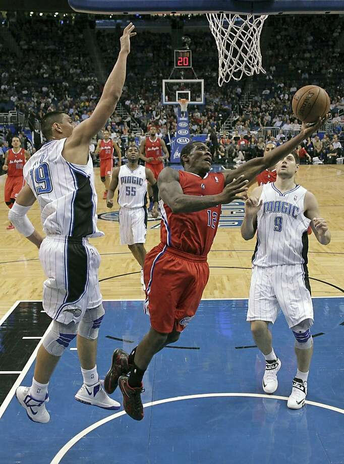 Eric Bledsoe (center) had 27 points as the Clippers topped the Magic without their three top scorers. Photo: John Raoux, Associated Press