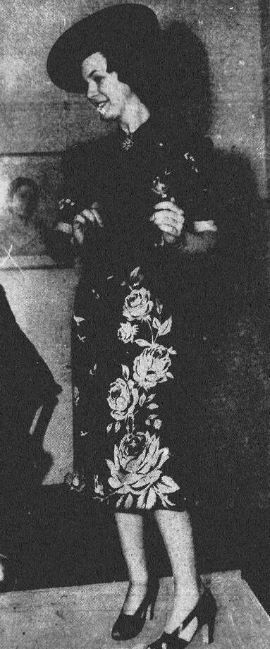 "Miss Dorothy Steves wore one of those attractive ""fitted like the paper on the wall"" dresses of black satin printed with huge roses of that pink shade which seems to be very popular this season at the weekly Bright Shawl style show Wednesday, when fashions from Siegel's Canadian were presented. Published in the San Antonio Light Feb. 3, 1938. Photo: File Photo"