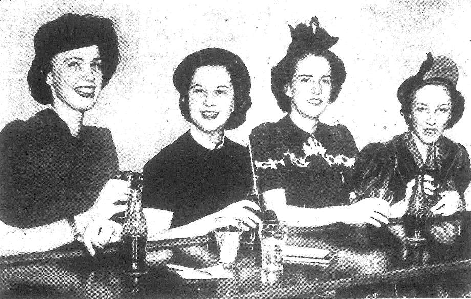 "Misses Catherine Cade (from left), Margaret Cox of Houston, Anne Holloway of Weimar and Margaret Robbins of Houston pose as they sip ""sody"" water at the Country Club. Mrs. C.C. Cade Monday entertained with a luncheon at the club in honor of her daughter and her guests. The girls Tuesday returned to the University of Texas, where they are students following a weekend study respite. Published in the San Antonio Light Feb. 2, 1938. Photo: File Photo"