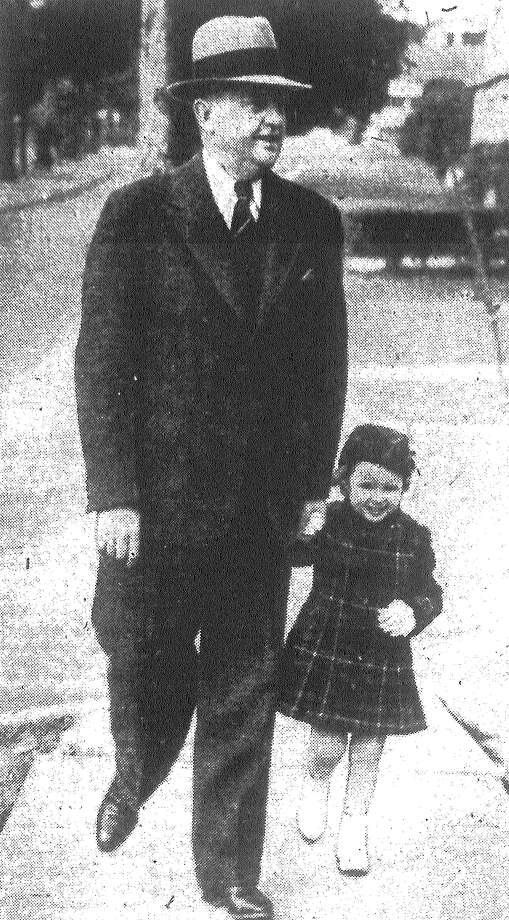 Little Joanne Steves takes her grandfather, Emmett Cahill, for a stroll. Joanne is the daughter of Mr. and Mrs. Sam Steves, who recently moved here from Corpus Christi. Mrs. Steves was formerly Joan Cahill. Published in the San Antonio Light Feb. 6, 1938. Photo: File Photo