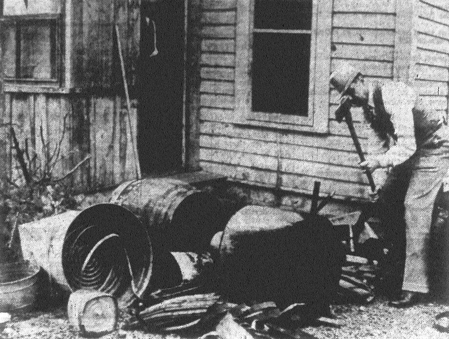 It looked like old times in San Antonio when federal and state liquor agents swooped down on a house in the 400 block of South Hamilton Street, and confiscated and smashed a whiskey still, Volstead era model. Here George W. Cox, an agent for the state liquor control board, applies an ax to the equipment. Published in the San Antonio News Feb. 5, 1938. Photo: File Photo