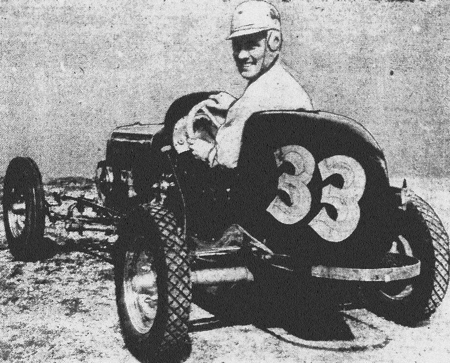 "Mel Wainright, the St. Louis midget auto racer, grins from the cockpit of his ""Jewel Box,"" streamlined chromium-and-aluminum race car. The ""Jewel Box,"" which cost Wainright $1,800 and months of labor, is powered by an outboard motor, and will be one of the cars to beat when the midget races open Sunday at the old dog racing track on the Seguin Highway. Published in the San Antonio Light Feb. 6, 1938. Photo: File Photo"