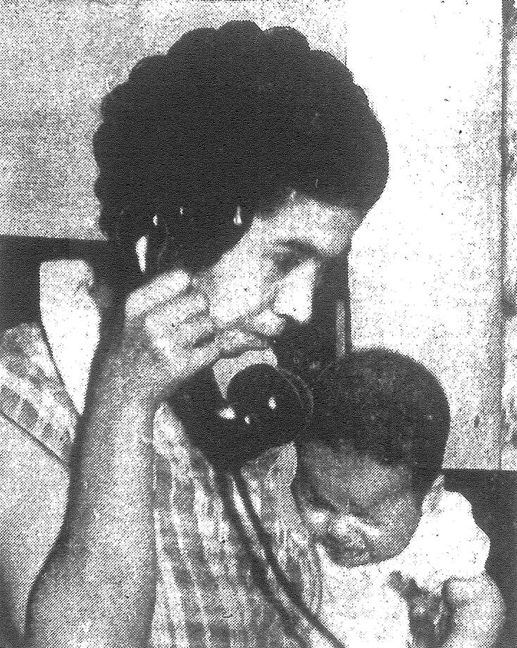 Five-month-old Ramon Ramirez, a victim of a police tear gas attack on 50 striking pecan shellers, cries in pain as his mother, Mrs. Anita Ramirez, frantically telephones for a doctor from a Guadalupe Street house. Published in the San Antonio Light Feb. 10, 1938. Photo: File Photo