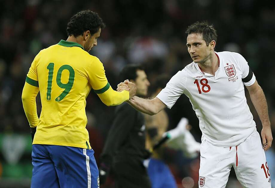 England's Frank Lampard, right shakes hands with Brazil's Fred, at the end match during following their international soccer game at Wembley stadium in London, Wednesday, Feb.  6, 2013. England won the match 2-1. (AP Photo/Kirsty Wigglesworth) Photo: Kirsty Wigglesworth, Associated Press