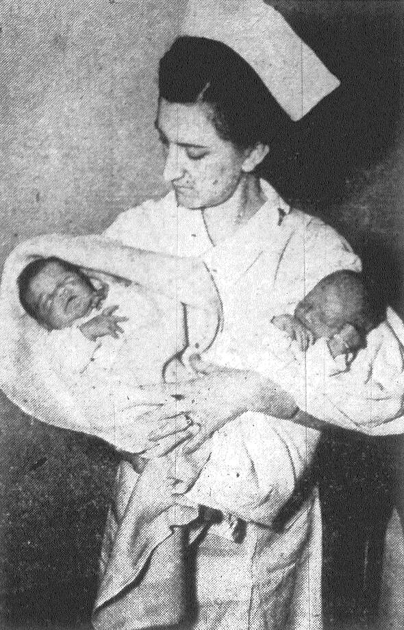 Miss Agnes Barre, an Army nurse at the new $3 million Station Hospital at Fort Sam Houston, is shown here with the first girl and boy born in the new hospital, which was occupied Monday. At the left is Melinda Hohensee, daughter of Technical Sgt. and Mrs. Emmett Hohensee, 11th Air Base Squadron of Randolph Field. At right is the son of Pvt. and Mrs. Andrew Tanner, C Company, 23rd Infantry, Fort Sam Houston. Melinda was born at 1:57 a.m. and the boy at 5:05 a.m. Tuesday. Published in the San Antonio Express Feb. 9, 1938. Photo: File Photo