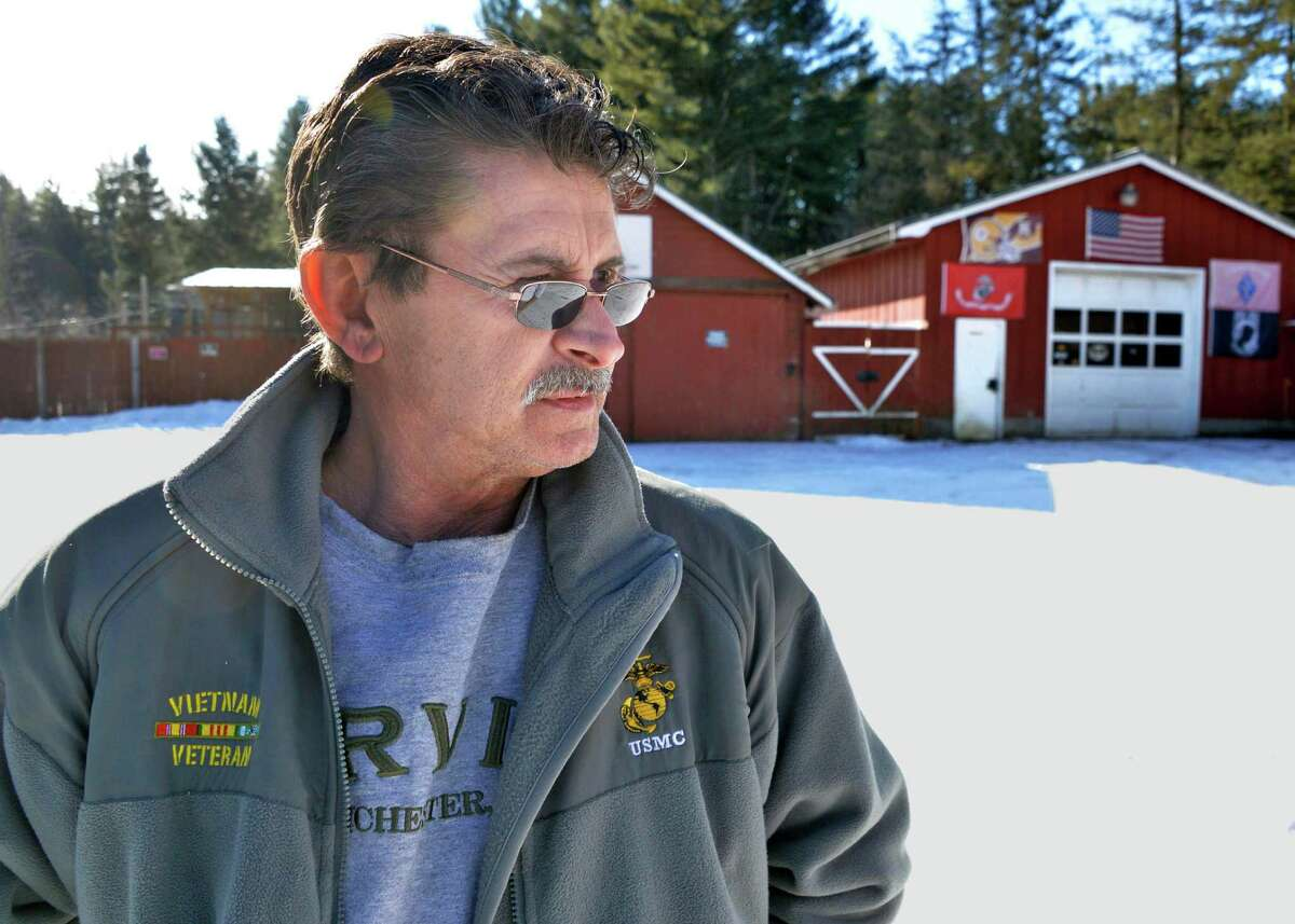 Steve Salton outside the animal enclosure at his Mayfield home Tuesday Feb. 5, 2013. (John Carl D'Annibale / Times Union)