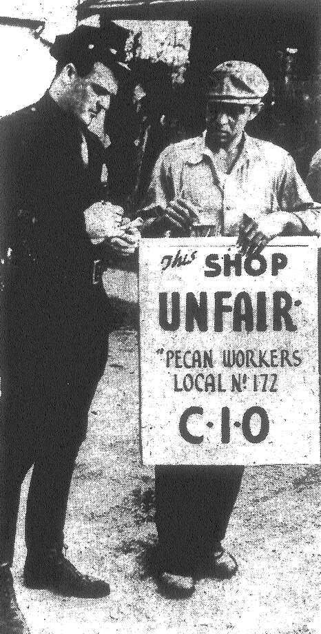 The display of a Congress of Industrial Organizations (C.I.O.) picket sign resulted in the arrest of a striking pecan sheller picketing a West Side zone by Arthur Perez, city policeman. The picket was booked at police headquarters for blocking a sidewalk. Published in the San Antonio Light Feb. 11, 1938. Photo: File Photo