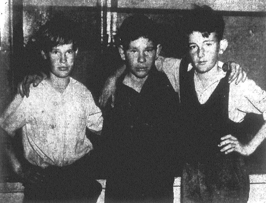 Billy Allen, 11 (from left), J.P. Harmon, 15, and Merrill Snyder, 14, pose at juvenile ward of the Bexar County Jail. The boys ended up there after piloting the Nancy Lee, a 12-foot, flat-bottomed boat, from Corpus Christi to Portland Thursday. From there, they boarded a truck that took them to Three Rivers, and then another that brought them to San Antonio. The boys then decided to sleep in a Missouri Pacific boxcar, where Radio Patrolmen A.D. Saucedo and Charles Meadows found them snuggled down in the loose hay trying to forget empty stomachs. The boys will be returned to Corpus Christi Friday. Published in the San Antonio Light Feb. 11, 1938. Photo: File Photo
