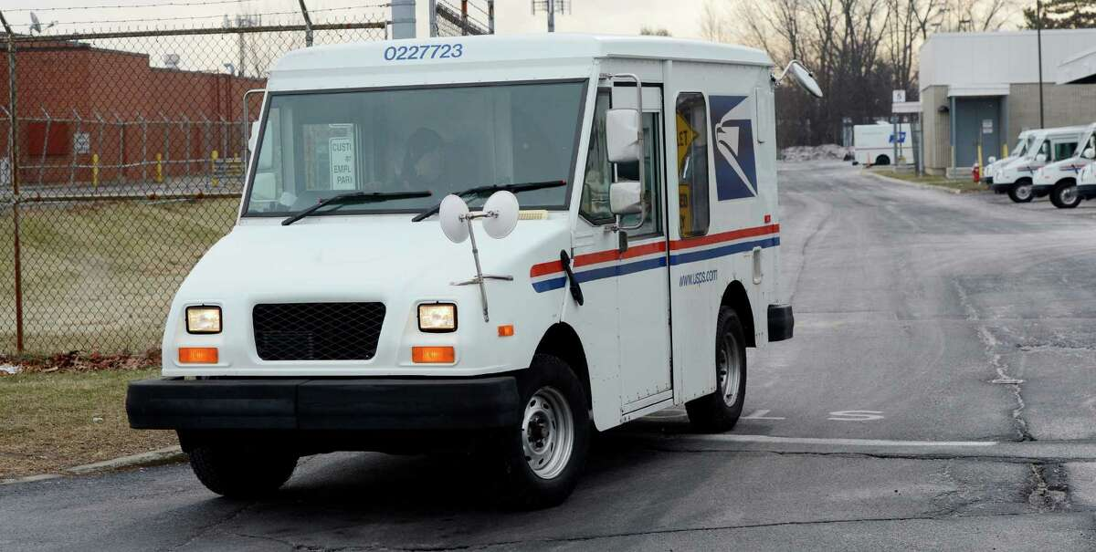 A U. S. Mail vehicle exits the U. S. Postal Processing and Distribution facility Feb. 6, 2013, on Karner Road in Colonie, N.Y. (Skip Dickstein/Times Union)