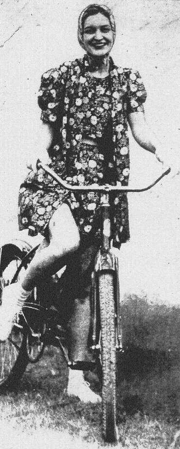 Mrs. C.E. Martin Jr. is another one of those cycle enthusiasts who, with her own bicycle, takes exercise with her friends by riding through the Olmos district daily. Published in the San Antonio Light Feb. 13, 1938. Photo: File Photo