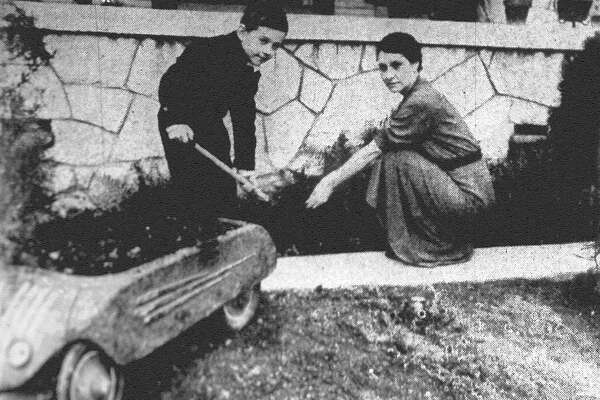 There's nothing like a nice garden in the springtime. Arnold McCoy Jr., of the 100 block of Elwood Avenue in Alamo Heights, is busily assisting Mrs. W.B. Walters of the same address in the planting of flowers beside the house. Published in the San Antonio Express Feb. 13, 1938.